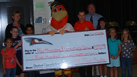 Sherman presents a $500 check to Northwestern Elementary