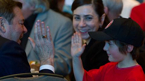 Scotiabank's David Poole gives a high-five to a future baseball star. (Paul Yates)