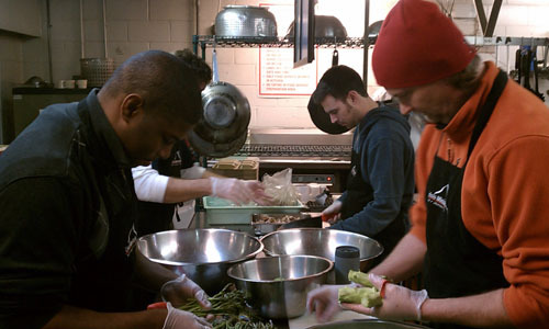 RiverDogs staff helping prepare nutritious meals to serve to guests of Crisis Ministries.