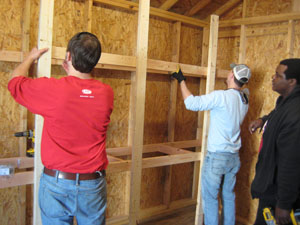The RiverDogs staff helps build a shed at Windwood Farm Home for Children.