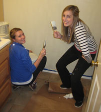 Special Events Manager, Kristen Wolfe and Promotions Intern, Haley Kirchner paint during their time volunteering at Windwood Farm Home for Children.