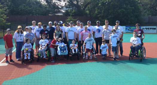 The Charleston RiverDogs buddy up with the Summerville Miracle League