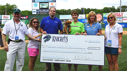 The Knights presented a check to the Human Society of York County on Sunday. (Audrey Stanek/Charlotte Knights)