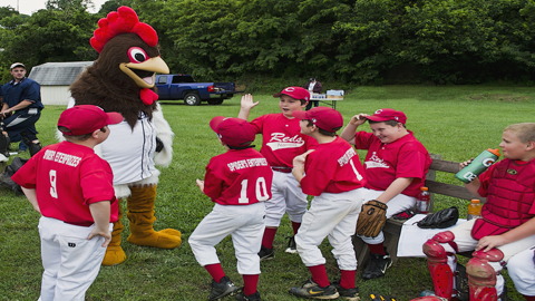 """P-Rays mascot, Roscoe the Rooster, entertains kids at a recent June 6 """"Little League Caravan"""" visit to Narrows, VA (Brandon Grose)"""