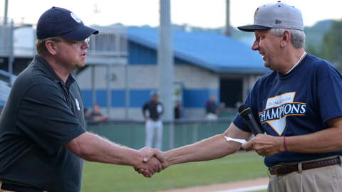 """Jason Solomonson of """"Remember the Miners"""" (left) accepts for the organization a donation check for $1372.00 from P-Rays General Manager Jim Holland. (Greg Barnett Photography)"""