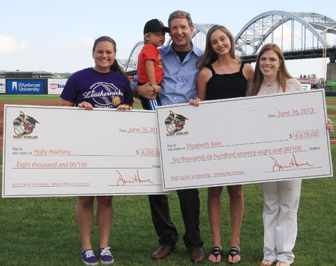 Holly Hoelting and Elizabeth Baer received their checks from Dave Heller and Jennifer Lucier Sunday afternoon. (Sean Flynn Photography)
