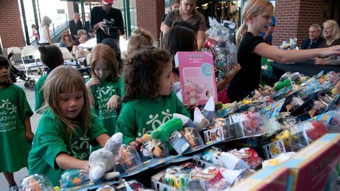 Kids from Boys and Girls Club of Truckee Meadows Early Learning Program select toys during today's press conference at Aces Ballpark. (David Calvert / Reno Aces)