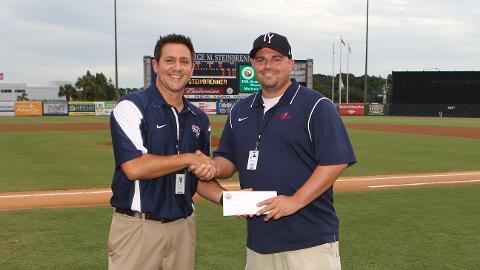 Asst. GM Matt Gess presented Michael with the FSL Scholarship. (Mark LoMoglio/Yankees)