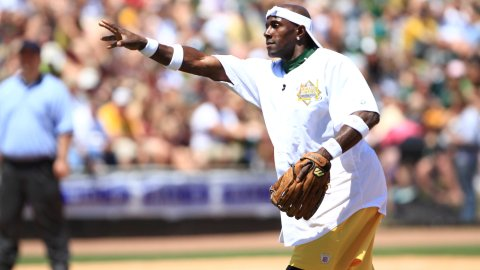 Donald Driver pitches during his 2012 Charity Softball Game. (Ann Mollica/Wisconsin Timber Rattlers)