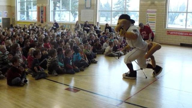 Fang T. Rattler could make an appearance at your school. But, you need to sign up for his Reading Club for him to do that. (Wisconsin Timber Rattlers)