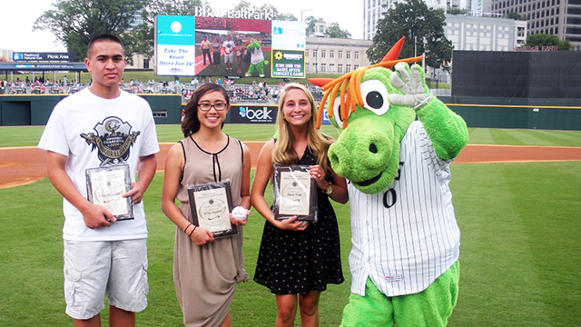 From L-R -- 2014 Charlotte Knights Healthcare Scholarship recipients: Adam Miranda (NC State), Xena Nguyen (UNC - Chapel Hill), Sarah York (Wake Forest) and Homer the Dragon.