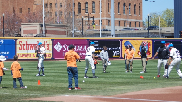 Ducks play catch with kids on field prior to MS awareness day at Canal Park.