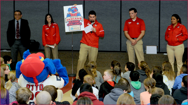 The Spokane Indians Front Office Staff inform children and OTTO the Mascot about the Reading Challenge presented by Molina Healthcare. (James Snook)